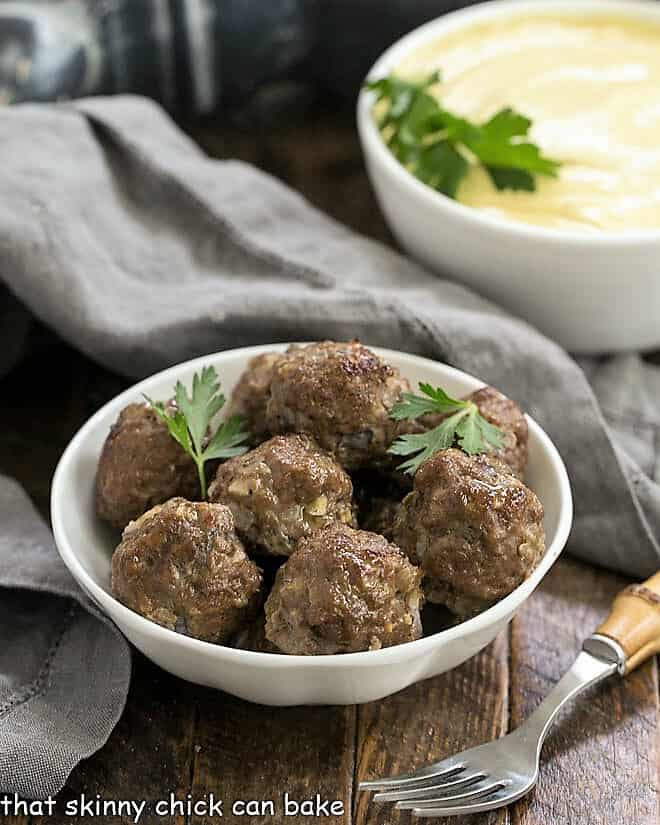 Indian Meatballs with Yogurt Sauce in white bowls