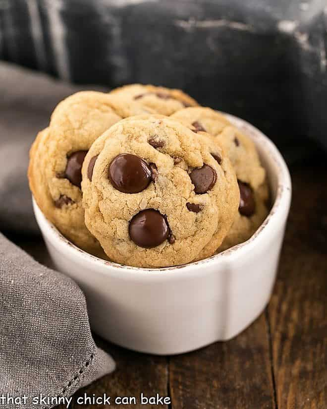 Killer chocolate chip cookies in a small white bowl