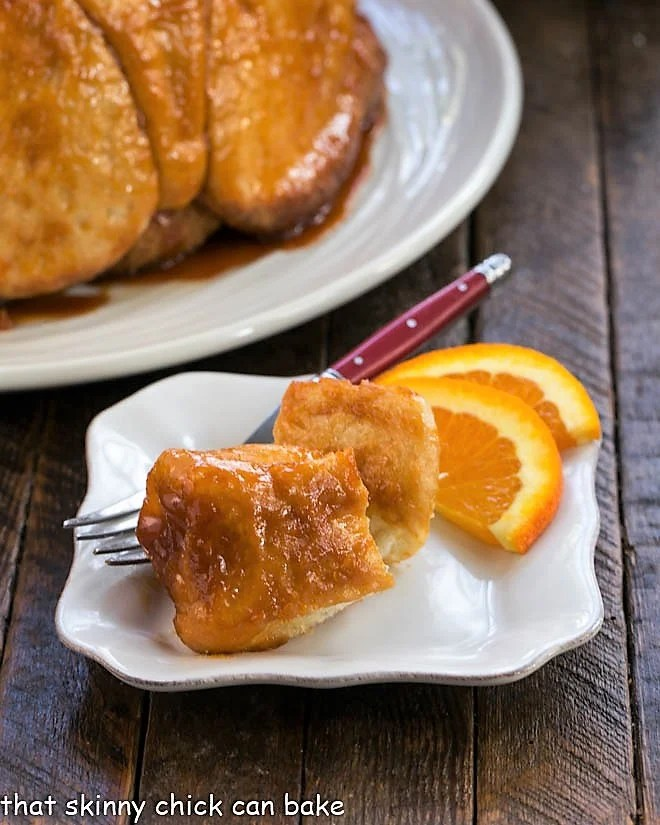 Easy Monkey Bread pieces on a small white plate with orange slices