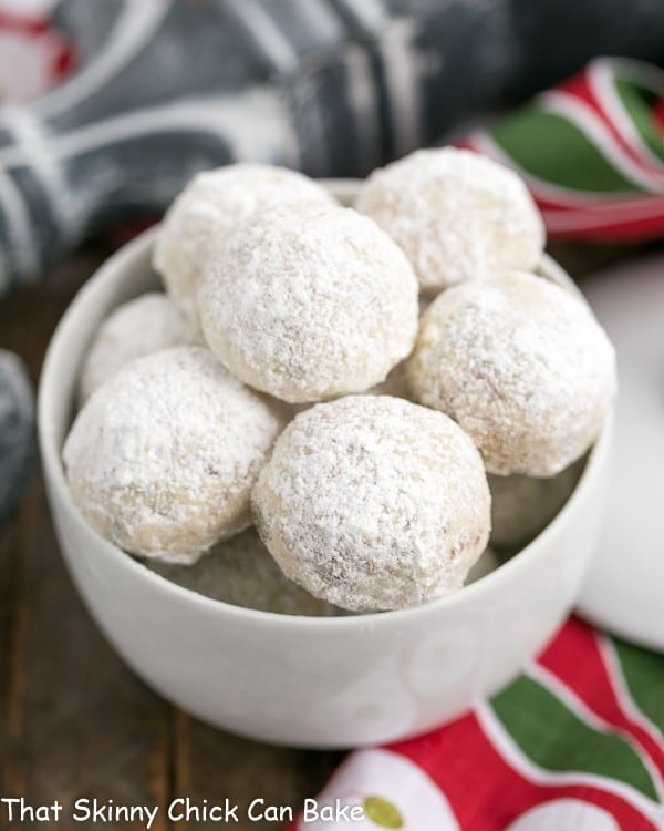 Holiday Pecan Snowballs in a round white bowl