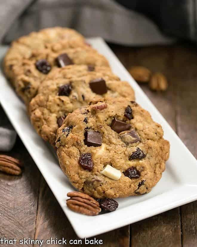 Oatmeal Cookies with Chocolate Chunks, Pecans, and Dried Cherries on a white rectangular tray