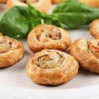 Prosciutto Gruyère Pinwheels made with homemade puff pastry on a white serving platter