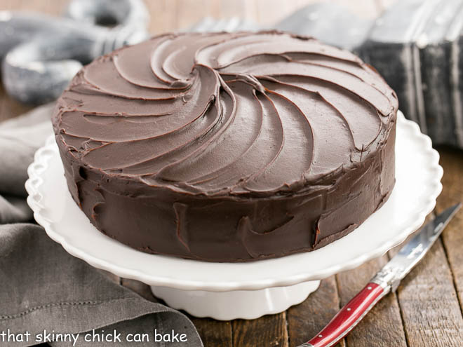 Vertical image of Triple Layer Cocoa Cake on a white cake stand