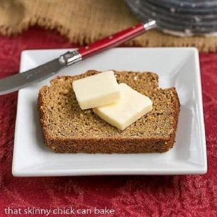 Easy Irish Brown Bread slice topped with butter on a square white plate