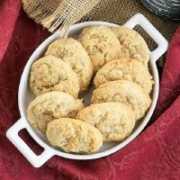 Overhead view of Chewy Coconut Cookies in an oval handled ceramic dish