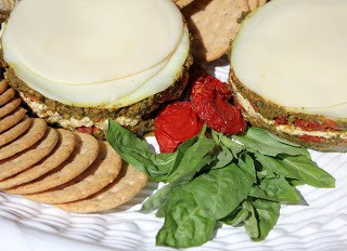 Sun-dried Tomato, Pesto and Cream Cheese Terrines on a platter