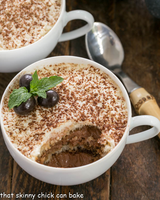 A cup of chocolate tiramisu with a spoonful removed