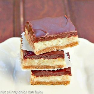 Mounds Bars | A fabulous bar from my childhood with a graham cracker crust, gooey coconut filling and ganache topping
