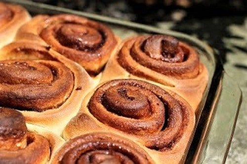 Cinnamon Buns in a baking dish without frosting