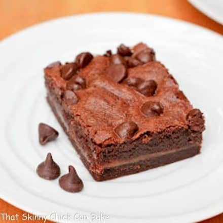 EASY Caramel Brownies slice on a white plate with a few chocolate chips