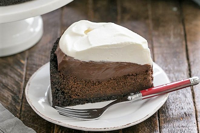 Slice of Mississippi Mud Pie on a white plate with a red handle fork