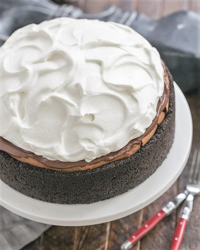 Overhead view of Oreo Mud Pie on a white cake stand