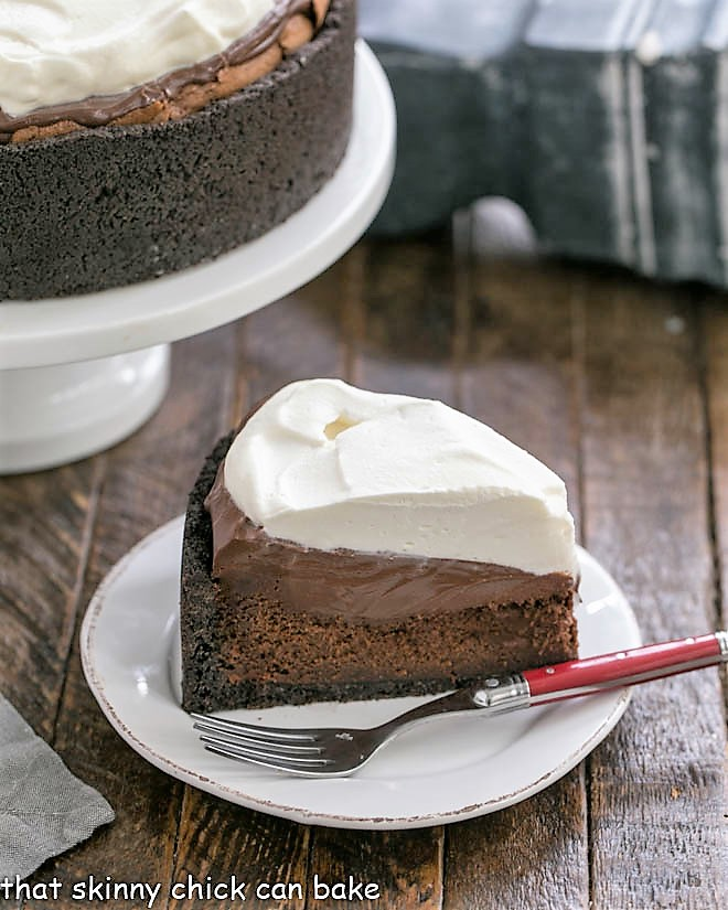 Slice of Mississippi Mud Pie in front of a cake stand
