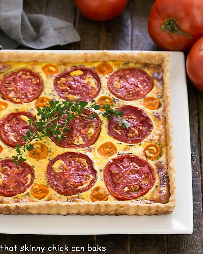 Overhead view of Tomato Gruyere Tart on a square white platter
