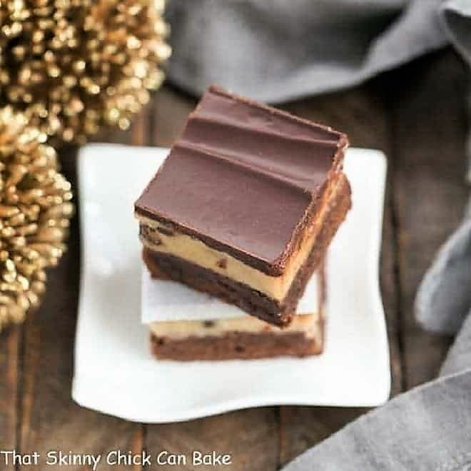 Chocolate Chip Cookie Dough Brownies stacked on a small white plate