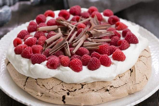 Chocolate Raspberry Pavlova - A sublime dessert with a chocolate meringue topped with berries and cream
