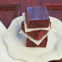 Stack of truffle brownies on a geometric white plate