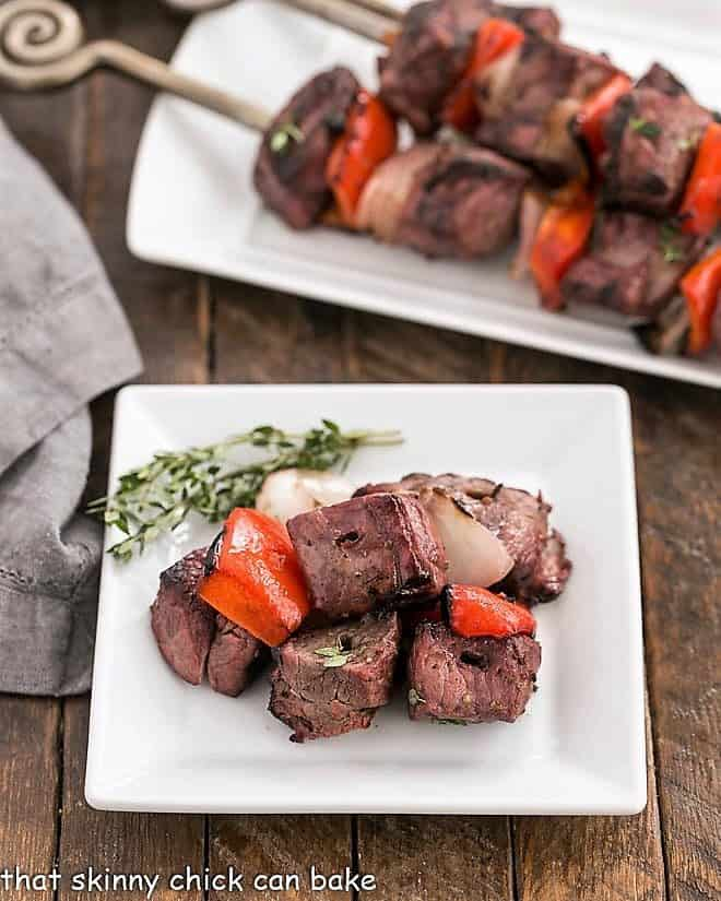 Marinated Greek Lamb Kebabs taken off the skewers on a square white plate