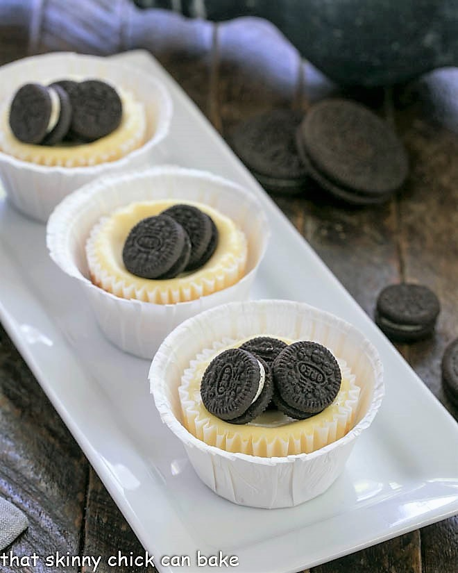 Mini Oreo Cheesecakes on a white ceramic tray