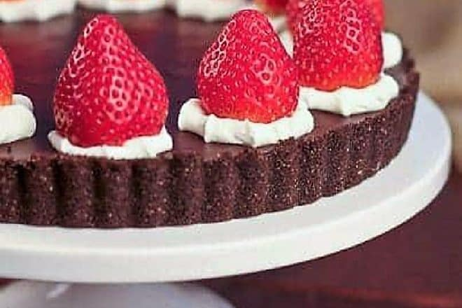 Ganache Topped Chocolate Tart on a white cake stand