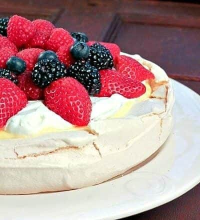 Pavlova with Lemon Curd | A meringue shell topped with lemon curd, cream and berries