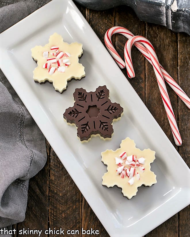 Overhead view of front and back of layered peppermint bark snowflakes
