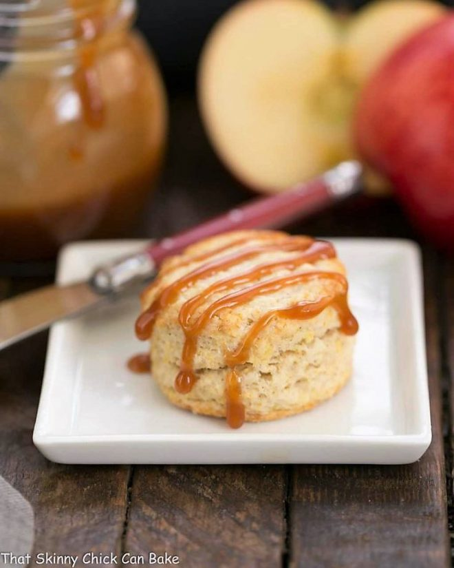 One Caramel Apple Scone on a square white platae with a red handled knife