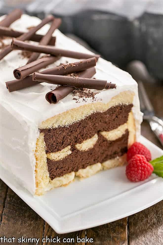 Chocolate Mousse Cake with slice removed, topped with chocolate curls