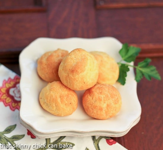 Overhead view of Parisian Cheese Puffs on a white plate