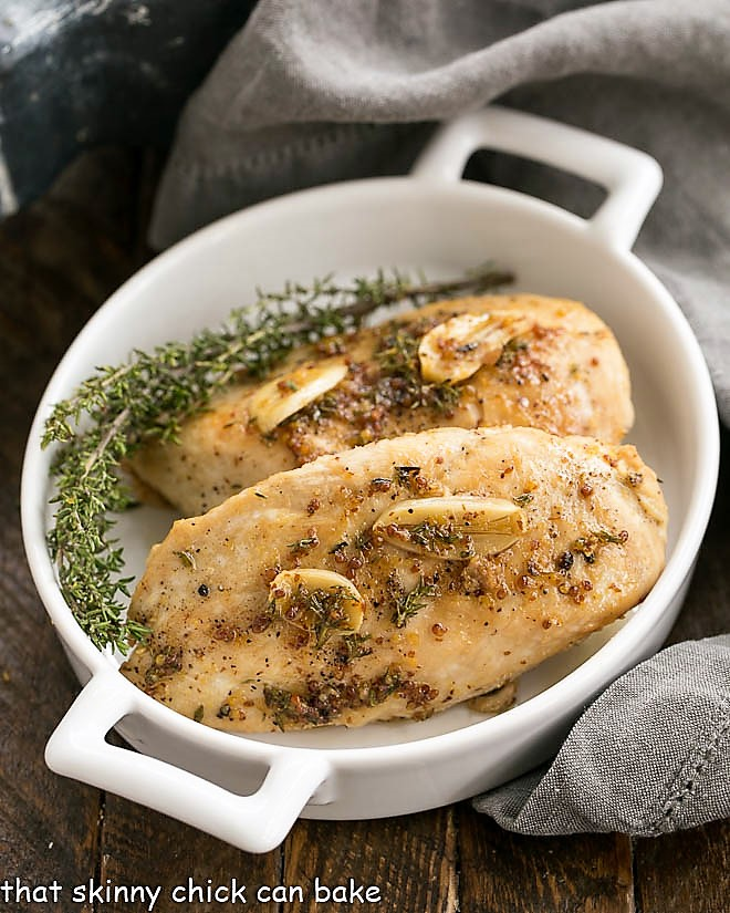 Maple Mustard Glazed Chicken Breasts in a white dish with handles