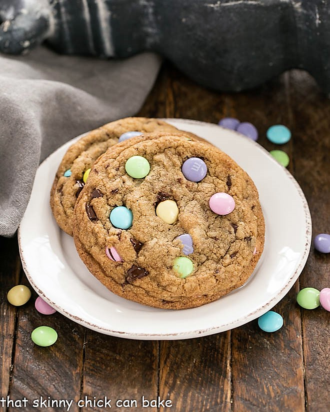 2 Brown Butter Easter Cookies with pastel M & M's on a round white plate