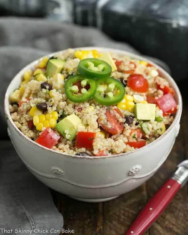 Quinoa Black Bean Salad with Lime Cumin Vinaigrette in a white ceramic bowl