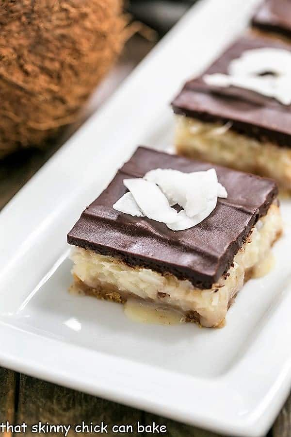 Coconut Mounds Bars on a white ceramic tray