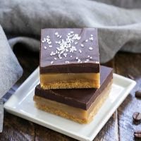 Caramel Espresso Bars stacked on a square white plate