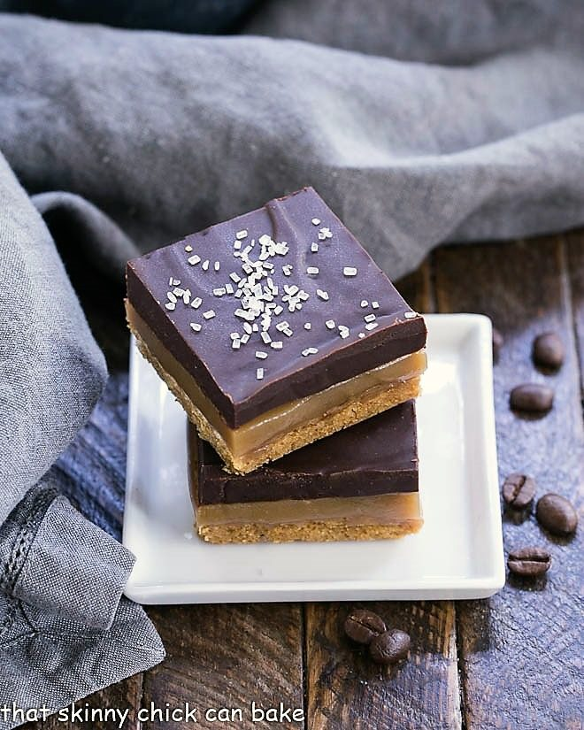 Caramel espresso bars stacked on a small square white plate