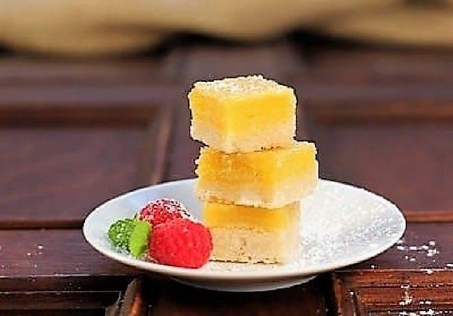 Meyer Lemon Bars stacked on a white plate