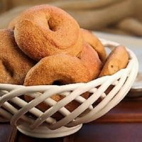 Whole Wheat Bagels in a white ceramic basket