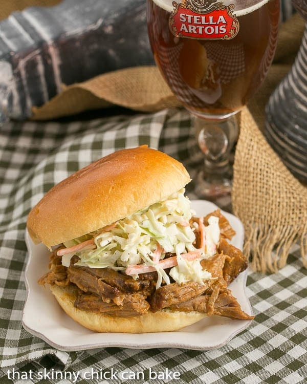 Pulled Pork Sandwiches topped with coleslaw served with a glass of beer