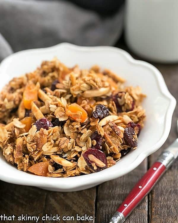 Vanilla Granola with Dried Fruit and vanilla in a white scalloped cereal bowl