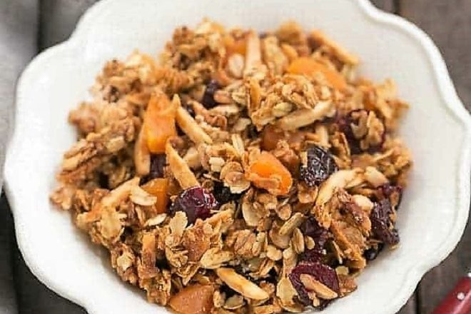 Overhead view of a white bowl filled with vanilla granola