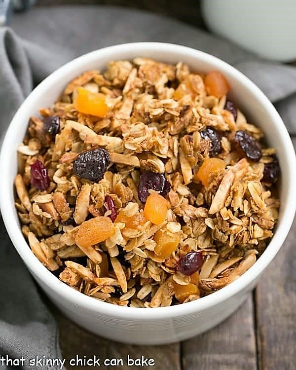 Overhead view of vanilla granola with dried fruit in a white bowl