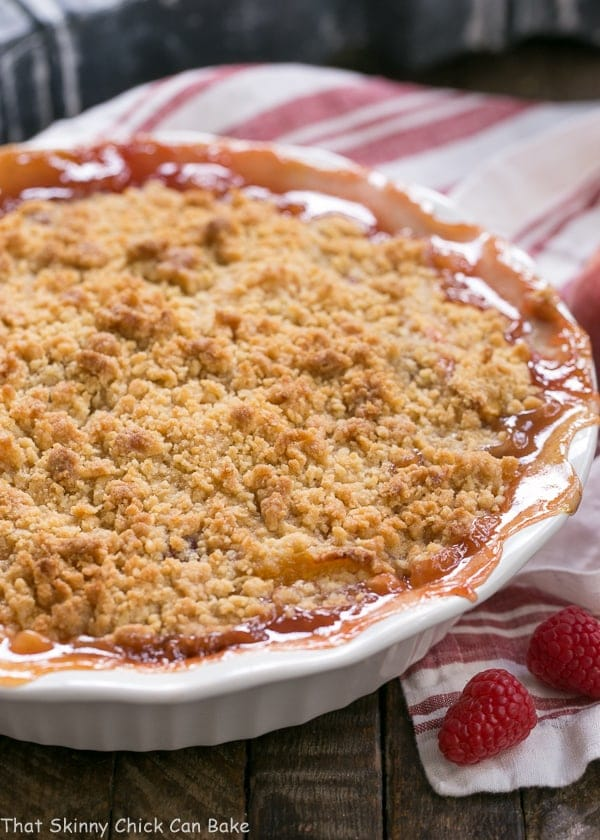 Peach Raspberry Crisp in a white porcelain pie plate