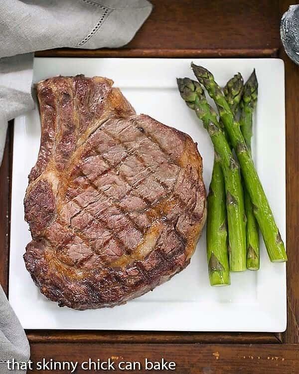Rib Eye Steak on a dinner plate with asparagus