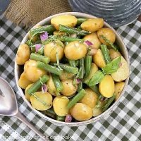 Overhead view of Potato and Green Bean Salad with Dijon Vinaigrette over a checked napkin