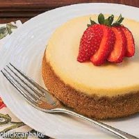 Crème Brûlée Cheesecake topped with a fanned strawberry