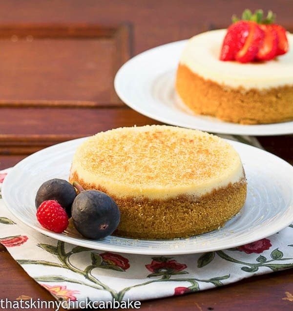 Crème Brûlée Cheesecake on a white plate garnished with fruit