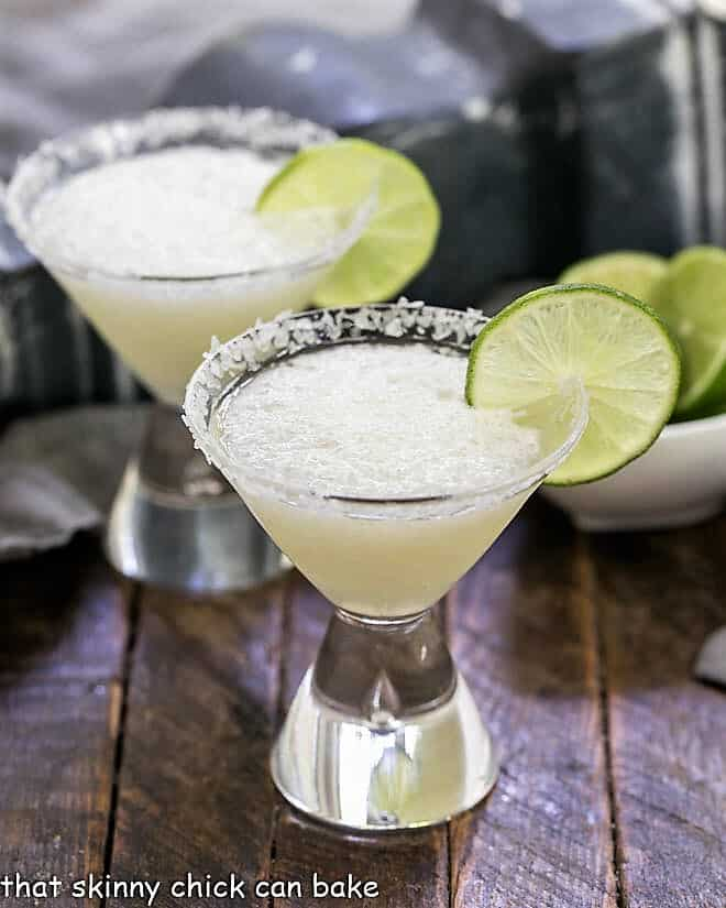 Easy 3-Ingredient Beer Margaritas in martini glasses with lime garnishes