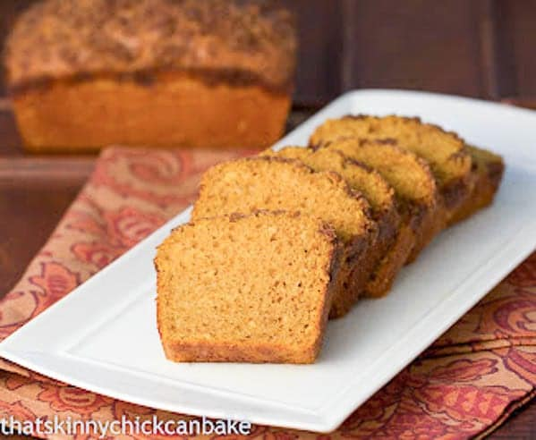 Streusel Topped Pumpkin Bread slices on a white tray