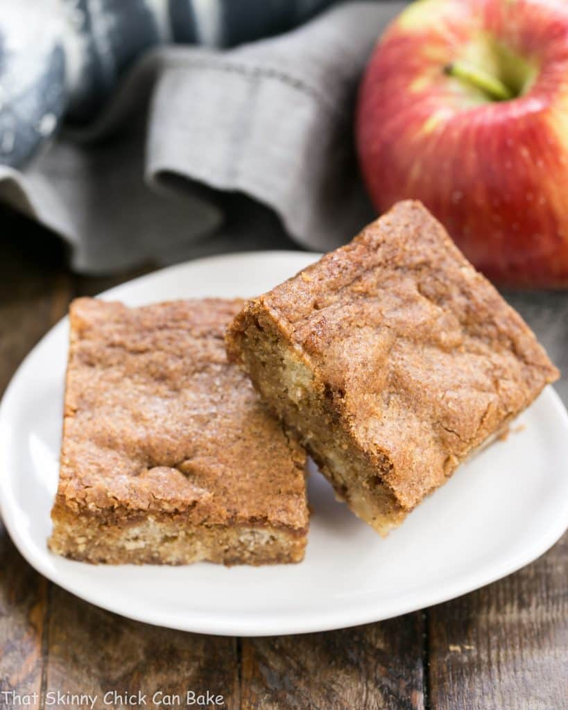 Apple Brownies on a white tear shaped ceramic plate