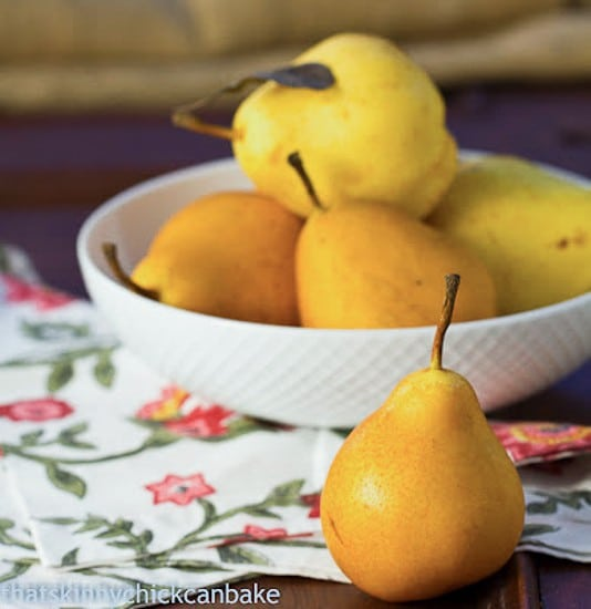 Spice-Poached Pears cooked in citrus, honey and spice infused liquid for a healthy dessert!